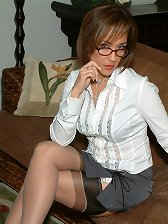 Hot lady in sexy glasses and nude stockings